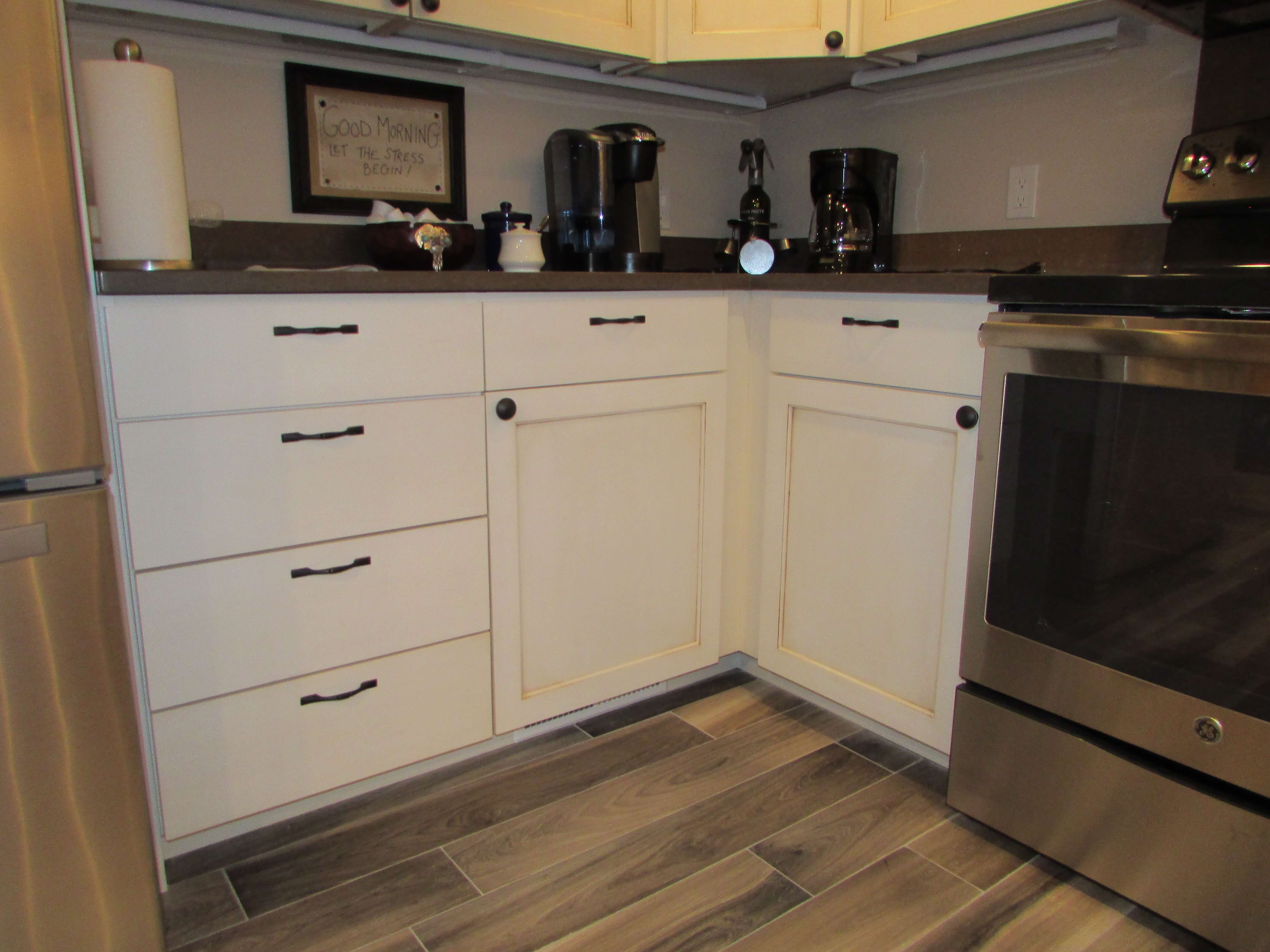 Recessed panel cabinet with antique white finish Ketchum Idaho