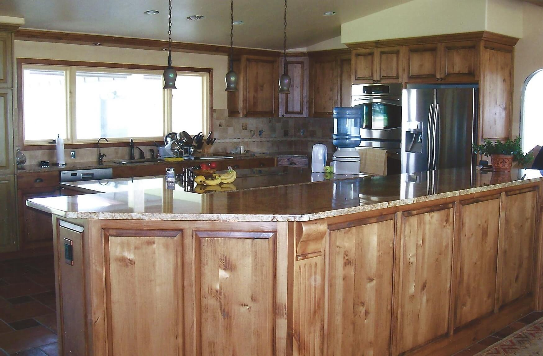 Rustic alder cabinet with hand hewn finish Hansen Idaho